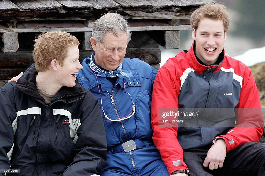 Prince Charles, Prince William and Prince Harry pose for photographs during the Royal Family's ski break in the region at Klosters on March 31, 2005 in Switzerland.