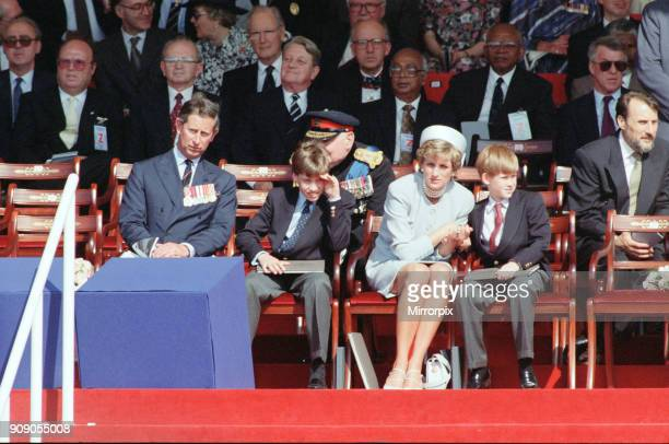 Prince Charles, Prince William, Diana Princess of Wales holding the hand of her son Prince Harry at a ceremony in Hyde Park, London, marking the 50th...