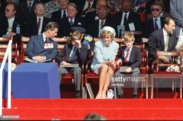 Prince Charles Prince William Diana Princess of Wales holding the hand of her son Prince Harry at a ceremony in Hyde Park London marking the 50th...