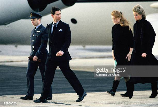 Prince Charles Princess Diana and Sarah Ferguson Duchess of York return to England with the coffin of their friend Major Hugh Lindsay at RAF Northolt...