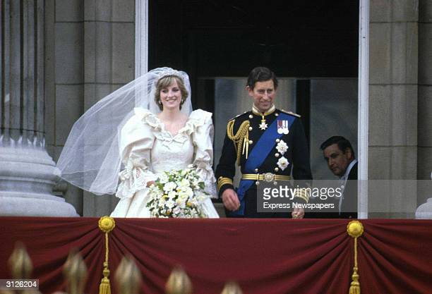 Prince Charles & Princess Diana stand on the balcony of Buckingham Palace after their wedding ceremony at St. Paul's Cathedral, London, England, July...