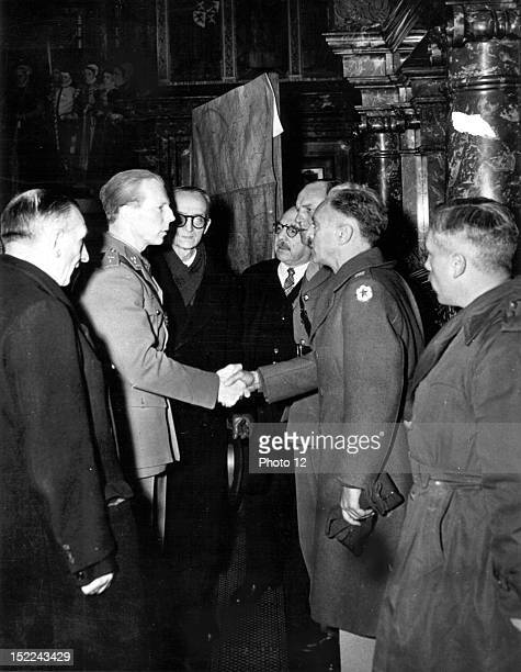 Prince Charles Regent of Belgium visits the great port city of Antwerp and shakes hands with a US Army officer