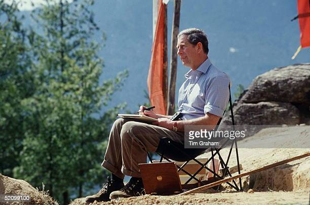 Prince Charles Sitting Down And Sketching In Bhutan