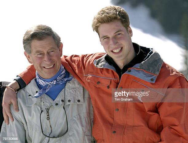 Prince Charles smiling with his teenage son Prince William at the start of their annual skiing holidays Prince William is showing affection by...