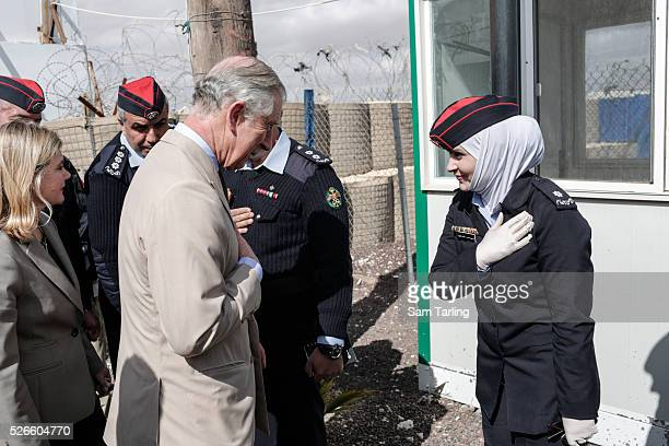 Prince Charles speaks to community police officers who were trained by retired British police officers working for Siren a private security firm at...