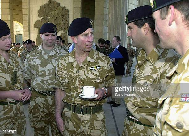 Prince Charles speaks with British troops ouside of Saddam Hussein's former palace February 8, 2004 in Basra, Iraq. Prince Charles is the first...