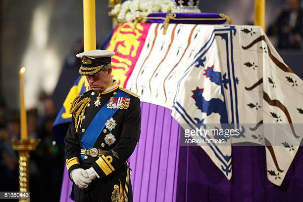 Prince Charles stands vigil beside the Queen Mother's coffin while it liesinstate at Westminster Hall in London 08 April 2002 The funeral ceremony...