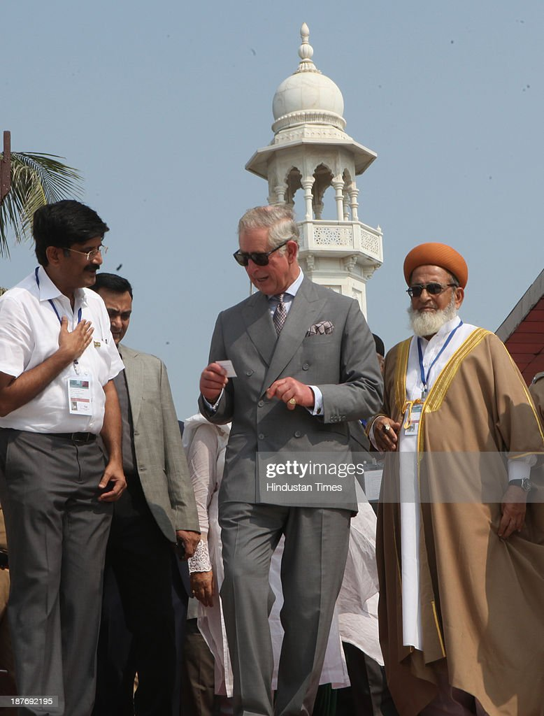 Prince Charles stands with a Muslim cleric during his visit at the Haji Ali Dargah, Mahalaxmi on November 11, 2013 in Mumbai, India. Haji Ali shrine is the resting abode of the Muslim saint Pir Haji Ali Shah Bukhari and is situated a few hundred meters ahead of the shoreline of the Arabian Sea. Prince Charles is on a nine-day-visit to the country with his wife, the Duchess of Cornwall, Camilla before leaving for Sri Lanka to attend the Commonwealth Heads of Government Meeting in Colombo.