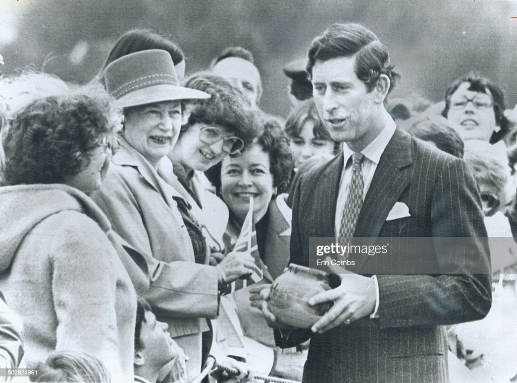 Prince Charles stops for a chat at the Victoria airport with a group of women who had presented him  : News Photo
