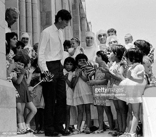 Prince Charles surrounded by children and nuns at the Lourdes House on Gozo near Malta on 5th July 1968