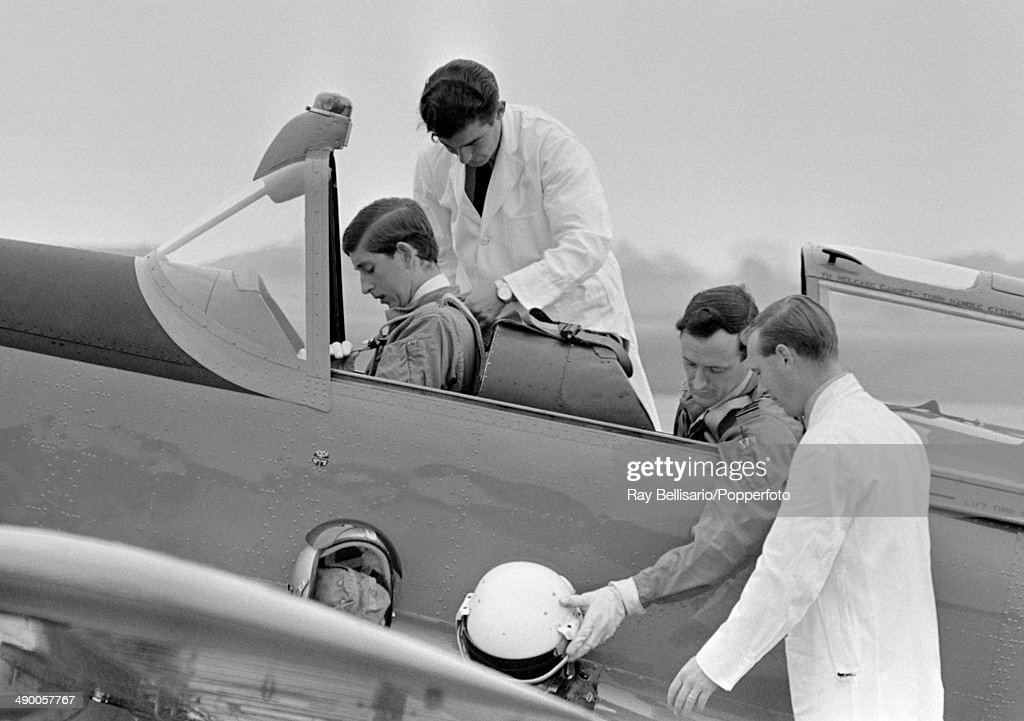 Prince Charles (in the cockpit) taking his first flying lesson from Squadron Leader Philip Pinney (seated, right) in an RAF Chipmunk at Tangmere in Sussex on 1st August 1968.