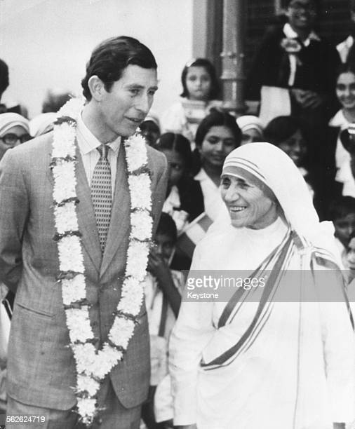 Prince Charles talking to Mother Teresa during his visit to her home for babies and children Calcutta December 1980