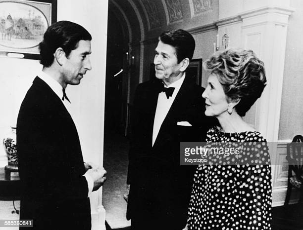 Prince Charles talking to President Ronald Reagan and his wife Nancy at a private dinner in the White House Washington DC May 2nd 1981