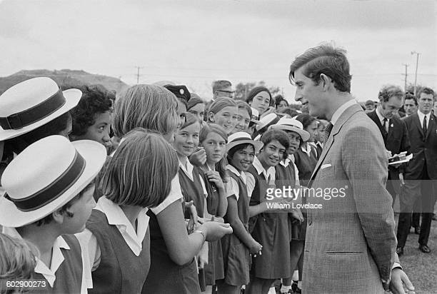 Prince Charles talks to a group of schoolgirls during a visit to New Zealand March 1970