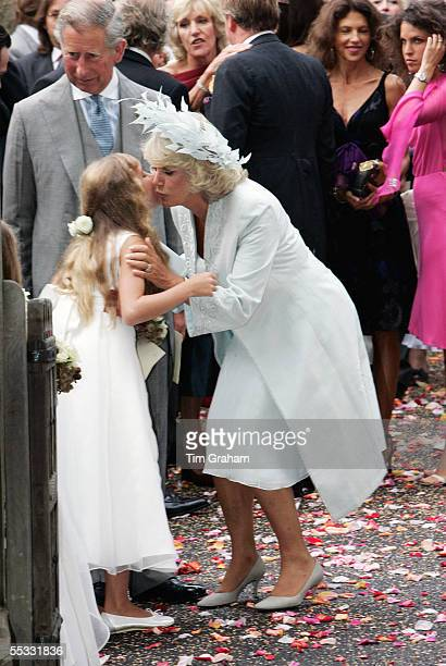 Prince Charles The Prince of Wales and Camilla Duchess of Cornwall at the wedding of Tom ParkerBowles to Sara Buys The Duchess bends down to kiss a...