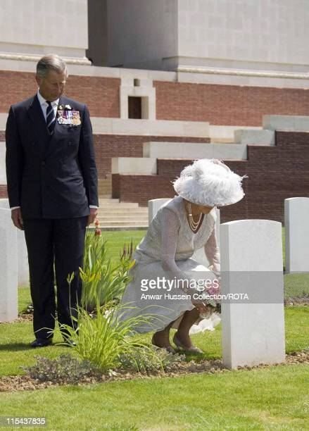 Prince Charles, the Prince of Wales and Camilla, Duchess of Cornwall lay flowers at the grave of a Battle of the Somme soldier at the Thiepval...