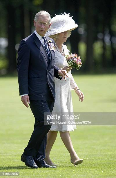 Prince Charles, the Prince of Wales and Camilla, Duchess of Cornwall carry flowers to the graves of a Battle of the Somme soldiers at the Thiepval...