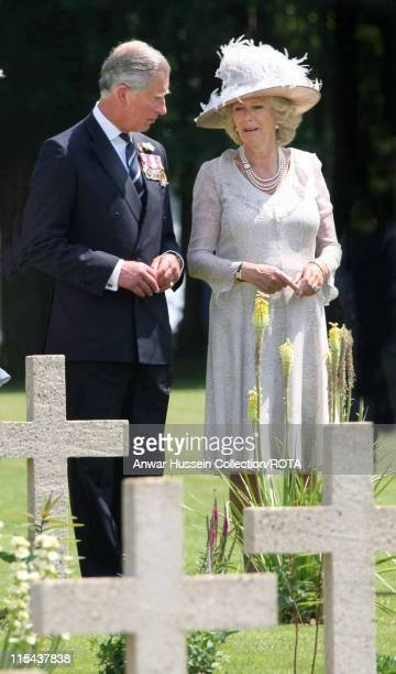 Prince Charles, the Prince of Wales and Camilla, Duchess of Cornwall look at the graves of Battle of the Somme soldiers at the Thiepval Monument...