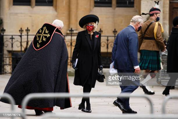 Prince Charles, the Prince of Wales, and Camilla, Duchess of Cornwall, wear face masks as they leave an Armistice Day service at Westminster Abbey in...
