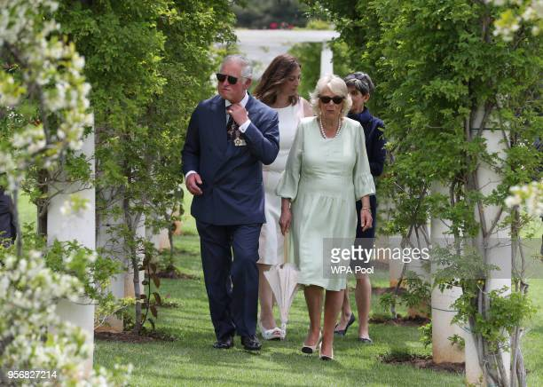 Prince Charles The Prince of Wales and Camilla Duchess of Cornwall pay their respects during a visit to Commonwealth War Graves on May 10 2018 in...
