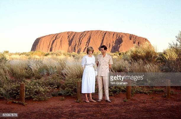Prince Charles, The Prince Of Wales And Diana, Princess Of Wales Standing In Front Of Ayers Rock During Their Official Tour Of Australia