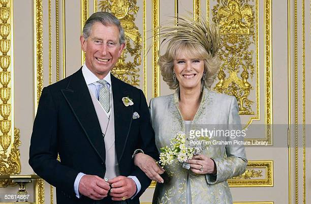 Prince Charles the Prince of Wales and his wife Camilla the Duchess Of Cornwall pose in the White Drawing Room at Windsor Castle for the Official...