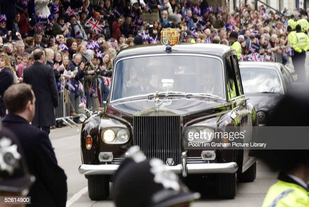 HRH Prince Charles the Prince of Wales and his wife Camilla the Duchess of Cornwall leave in a claret Phantom VI Rolls Royce custombuilt and...