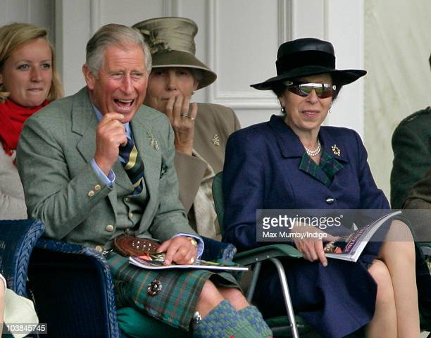 Prince Charles The Prince of Wales and Princess Anne The Princess Royal laugh as they watch the tug of war competion at the Braemar Highland Games at...