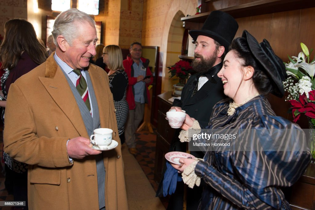 Prince Charles, The Prince of Wales drinks tea with actors wearing period dress during a visit to Castell Coch to learn about the castle's history, refurbishment and programme of community activities on December 8, 2017 in Cardiff, Wales.
