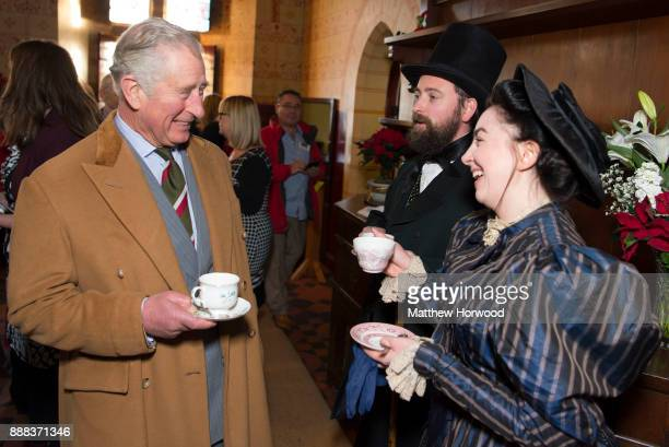 Prince Charles The Prince of Wales drinks tea with actors wearing period dress during a visit to Castell Coch to learn about the castle's history...