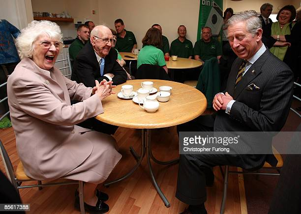 Prince Charles the Prince of Wales enjoys afternoon tea with Etty Thompson and Joe Rose in Joe's Cafe during his visit to the Blacon Community Trust...