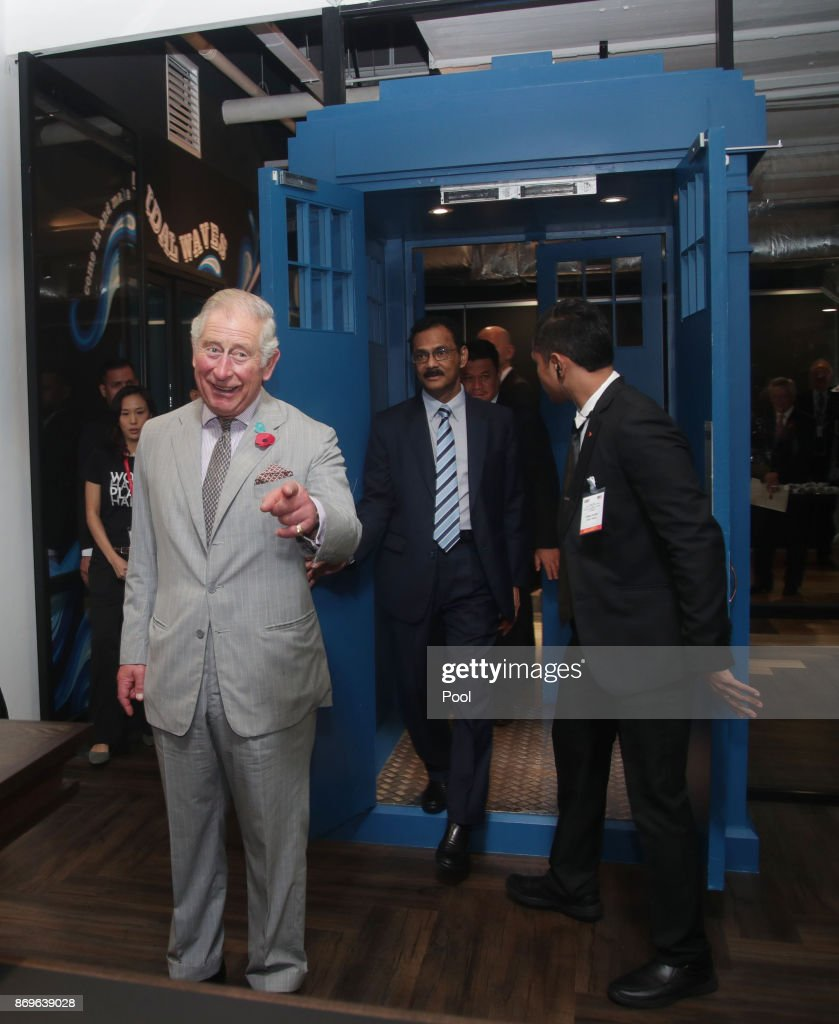 Prince Charles, The Prince of Wales enters through a door shaped in the style of Dr Who's Tardis during his visit to Worq Co-working space for Young Entrepreneurs, on November 3, 2017 in Kuala Lumpur, Malaysia.