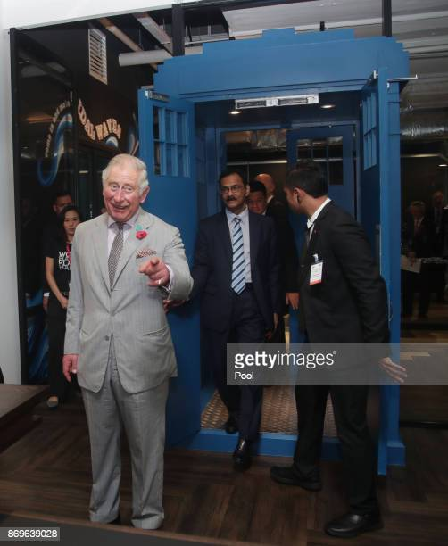Prince Charles The Prince of Wales enters through a door shaped in the style of Dr Who's Tardis during his visit to Worq Coworking space for Young...