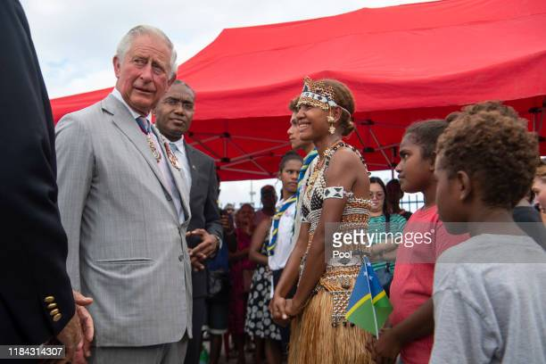 Prince Charles The Prince of Wales greets members of the public following a wreath laying ceremony at the Solomon Islands Scouts Memorial on the...