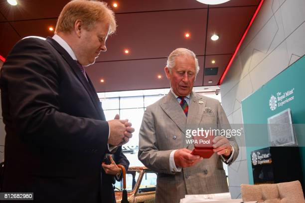 Prince Charles The Prince of Wales is presented the new commemorative £5 coin celebrating the Duke of Edinburgh's lifetime in the public service that...