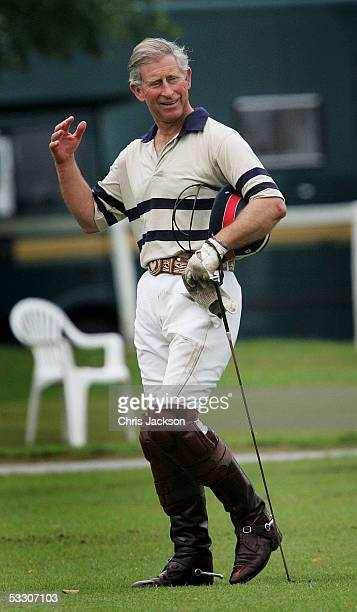 Prince Charles the Prince of Wales is seen during a break in play as he plays polo for HSBS against Virginia State polo at Cirencester Park Polo Club...
