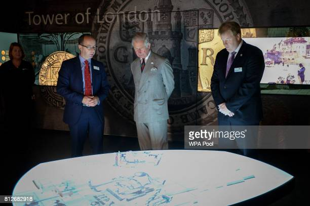 Prince Charles The Prince of Wales is shown an interactive display by Director of the Royal Mint Museum Dr Kevin Clancy and Royal Mint CEO Adam...