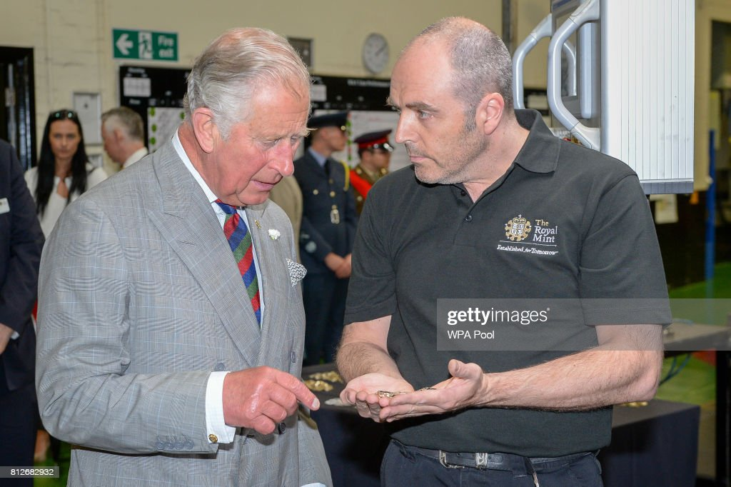 Prince Charles, The Prince of Wales is shown the new £1 coin minting process by Mark Rundele during a tour of The Royal Mint's visitor centre on July 11, 2017 in Heol-Y-Sarn, Wales.