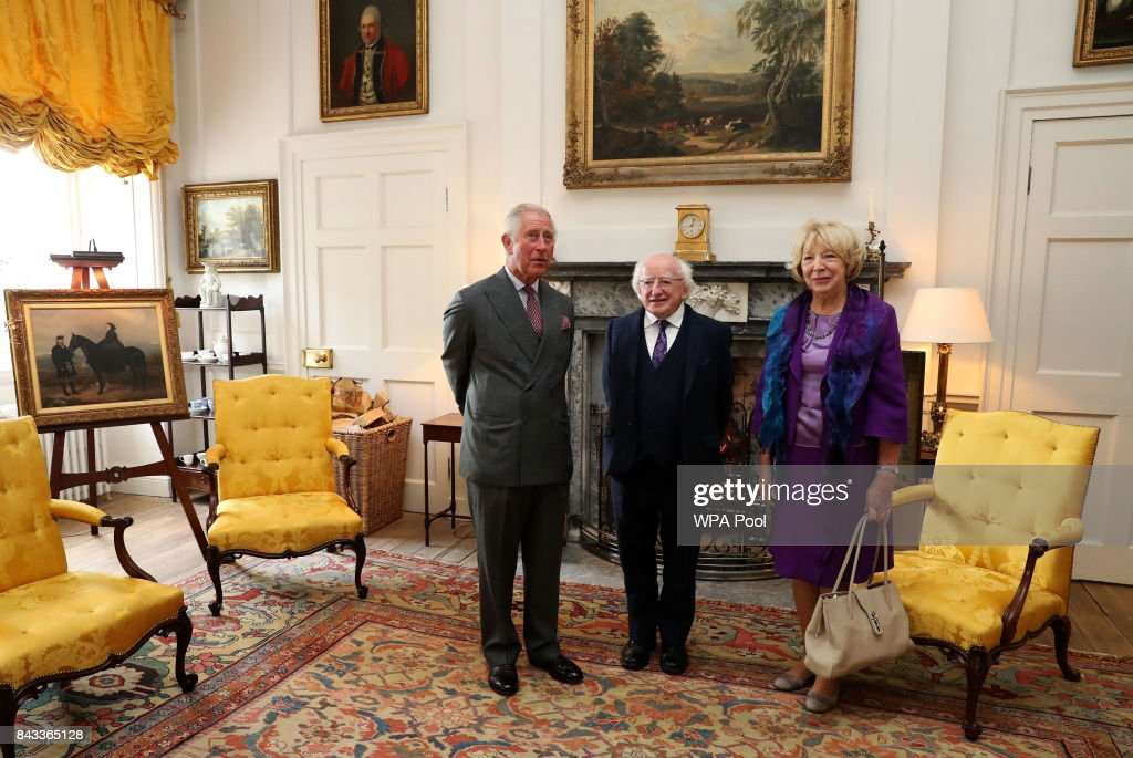 Prince Charles, The Prince of Wales, known as the Duke of Rothesay in Scotland, with the President of Ireland Michael D Higgins and his wife, Sabina Coyne in the Yellow Room at Dumfries House on September 6, 2017 in Cumnock, Scotland.
