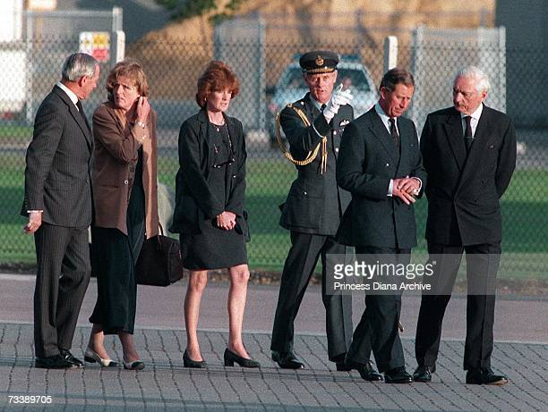 Prince Charles the Prince of Wales Lady Jane Fellows and Lady Sarah McCorquodale with officials at RAF Northolt to meet the coffin of their sister...