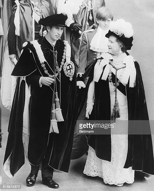 Prince Charles the Prince of Wales marches in procession with his grandmother Queen Elizabeth the Queen Mother from St George's Hall to the Queen's...