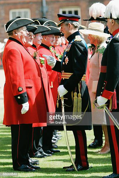 Prince Charles, the Prince of Wales, meets Chelsea Pensioners at the annual Founder's Day Parade at the Royal Hospital in Chelsea on June 9, 2005 in...