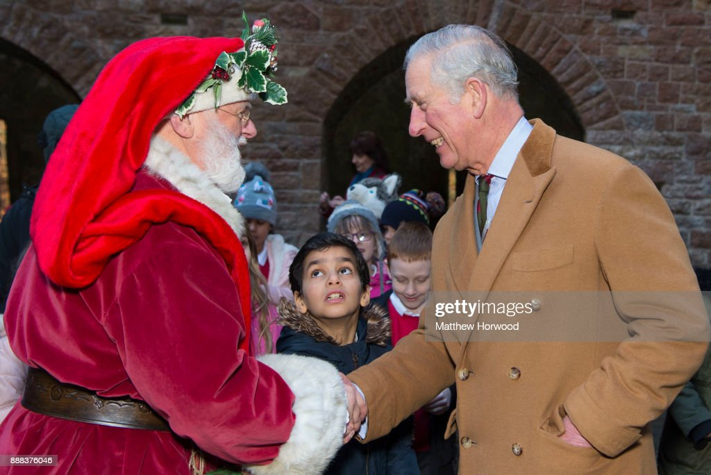 Prince Charles, The Prince of Wales meets Father Christmas during a visit to Castell Coch to learn about the castle's history, refurbishment and programme of community activities on December 8, 2017 in Cardiff, Wales.