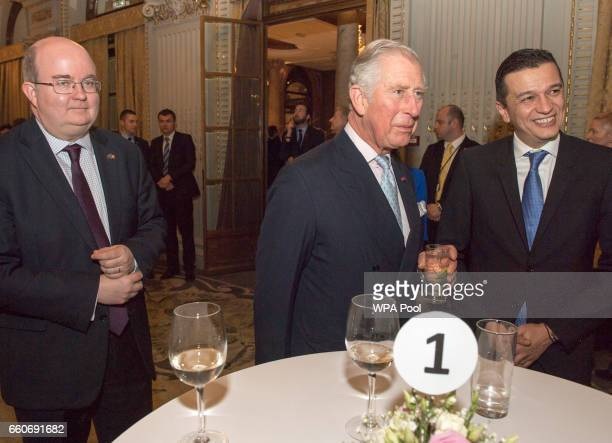 Prince Charles The Prince of Wales meets the Romaian Prime Minister Sorin Grindeanu while attending a reception at The Hilton Hotel Bucharest on...
