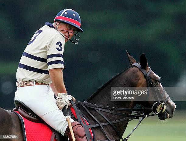 Prince Charles the Prince of Wales plays polo for HSBS against Virginia State polo at Cirencester Park Polo Club on July 30 2005 in Cirencester...