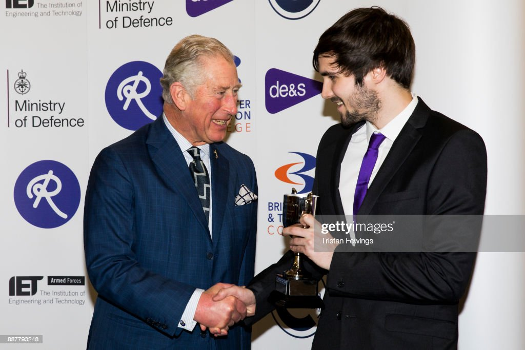 Prince Charles, The Prince of Wales presents Thomas Diaper-Fox with the Winner (Phase 2) Individual Design and Manufacturing award for the Tom Nevard Memorial Competition at the MOD Apprenticeship Awards held at The Ministry Of Defence on December 7, 2017 in London, England. The annual event celebrates the achievements of Defence Engineering apprentices which is run by the MOD's Department for Equipment and Support (DE&S).This year His Royal Highness presented the inaugural Prince of Wales's Award for Services to Defence Engineering.