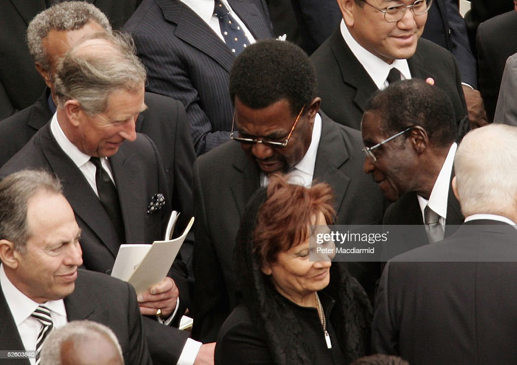 Prince Charles, the Prince of Wales, shakes hands with Zimbabwe's President Robert Mugabe during Pope John Paul II's funeral in St. Peter's Square on April 8, 2005 in Vatican City. President Mugabe, defied a European Union travel ban and flew from Zimbabwe unannounced to join world leaders attending Pope John Paul II's funeral .