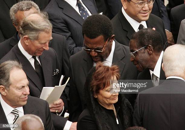 Prince Charles the Prince of Wales shakes hands with Zimbabwe's President Robert Mugabe during Pope John Paul II's funeral in St Peter's Square on...