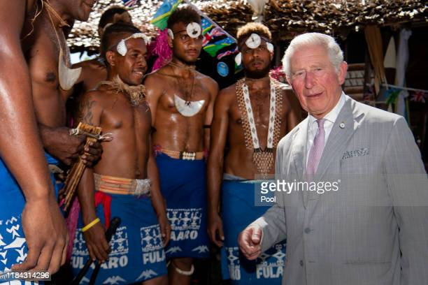 Prince Charles The Prince of Wales talks to dancers at Government House on the second day of the royal visit 24th November 24 2019 in Honiara Solomon...