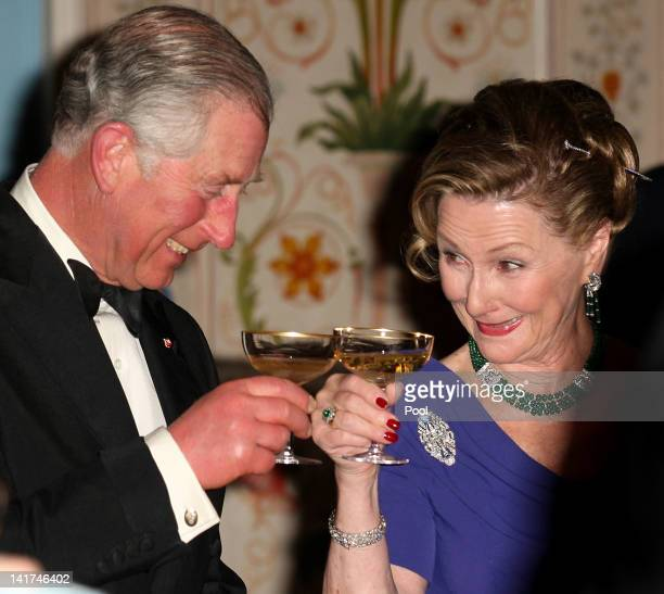 Prince Charles the Prince of Wales toasts with Queen Sonja of Norway during an official Dinner at the Royal Palace March 20 2012 in Oslo Norway